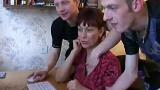 Russian boys teaching mom how to use the computer.